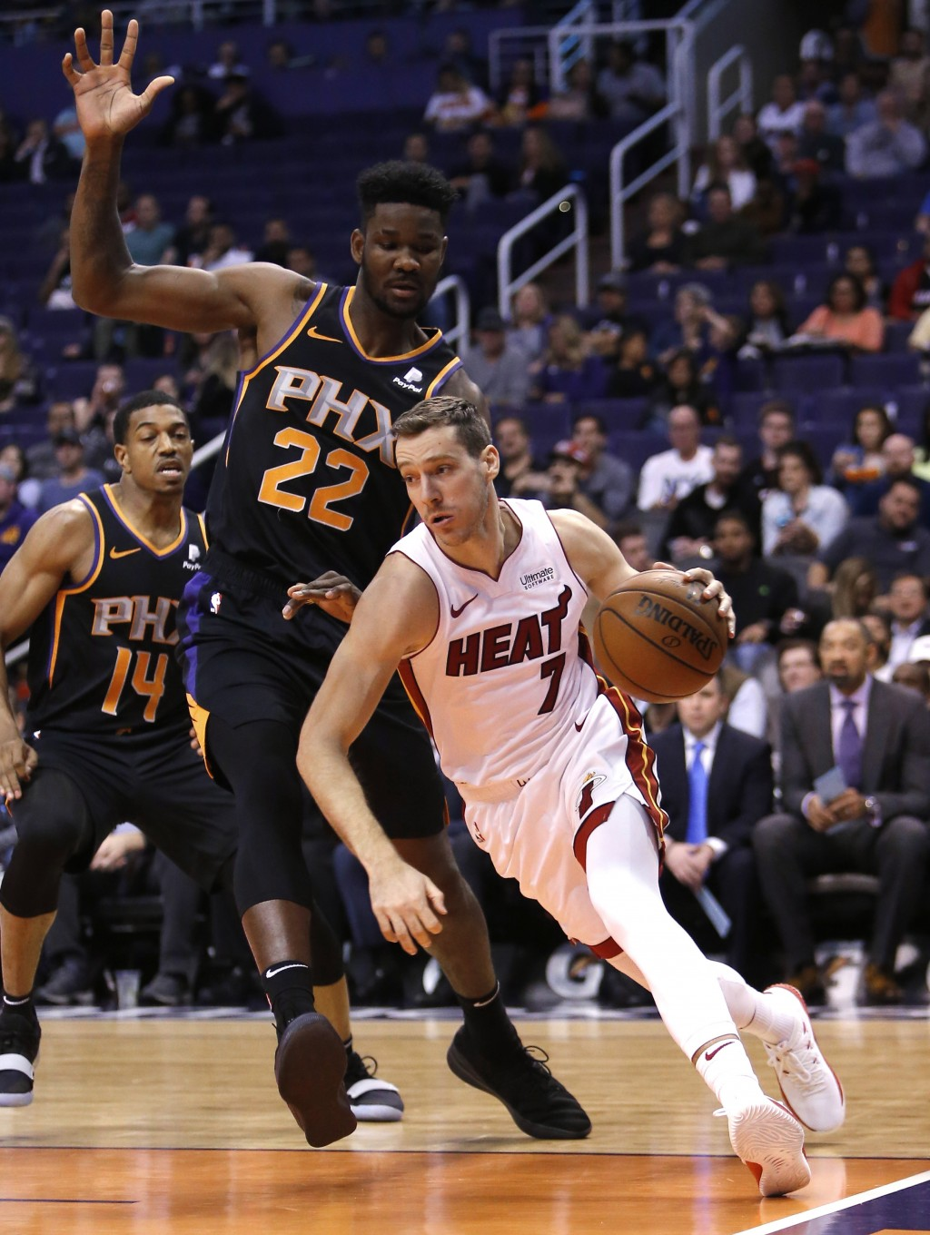 Miami Heat guard Goran Dragic (7) drives on Phoenix Suns center Deandre Ayton during the first half of an NBA basketball game Friday, Dec. 7, 2018, in