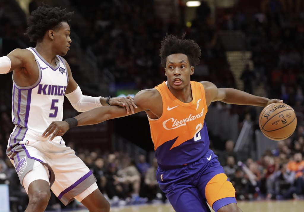 Cleveland Cavaliers' Collin Sexton (2) drives to the basket against Sacramento Kings' De'Aaron Fox (5) in the first half of an NBA basketball game, Fr