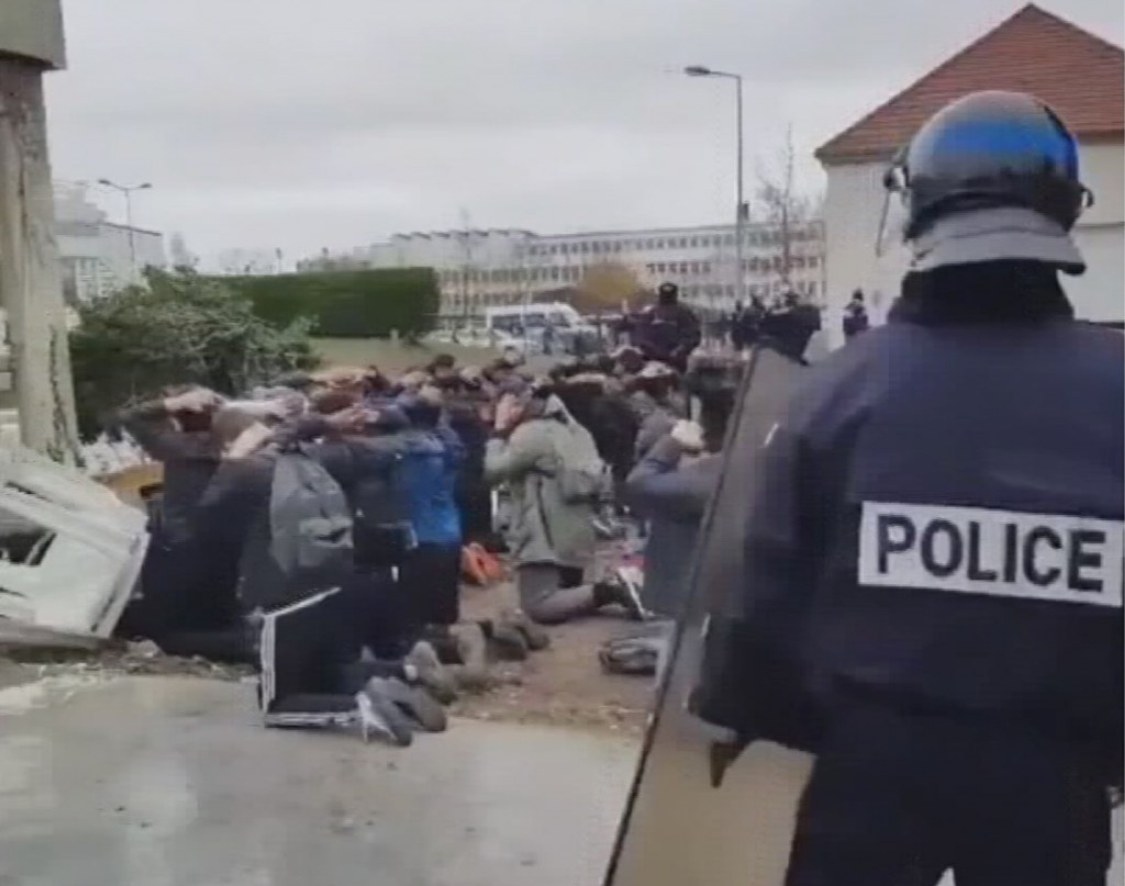 In this image taken from amateur video, showing police as they detain a large number of students Thursday Dec. 6, 2018, at Mantes-la-Jolie, France.  I