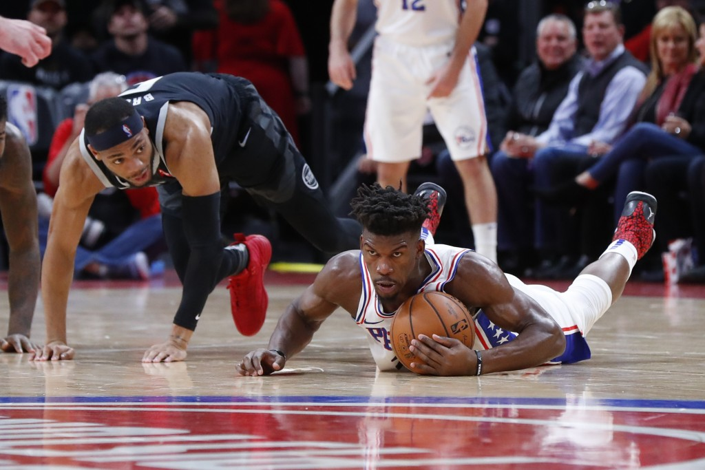 Philadelphia 76ers guard Jimmy Butler (23) collects the ball on the floor from Detroit Pistons guard Bruce Brown (6) in the first half of an NBA baske