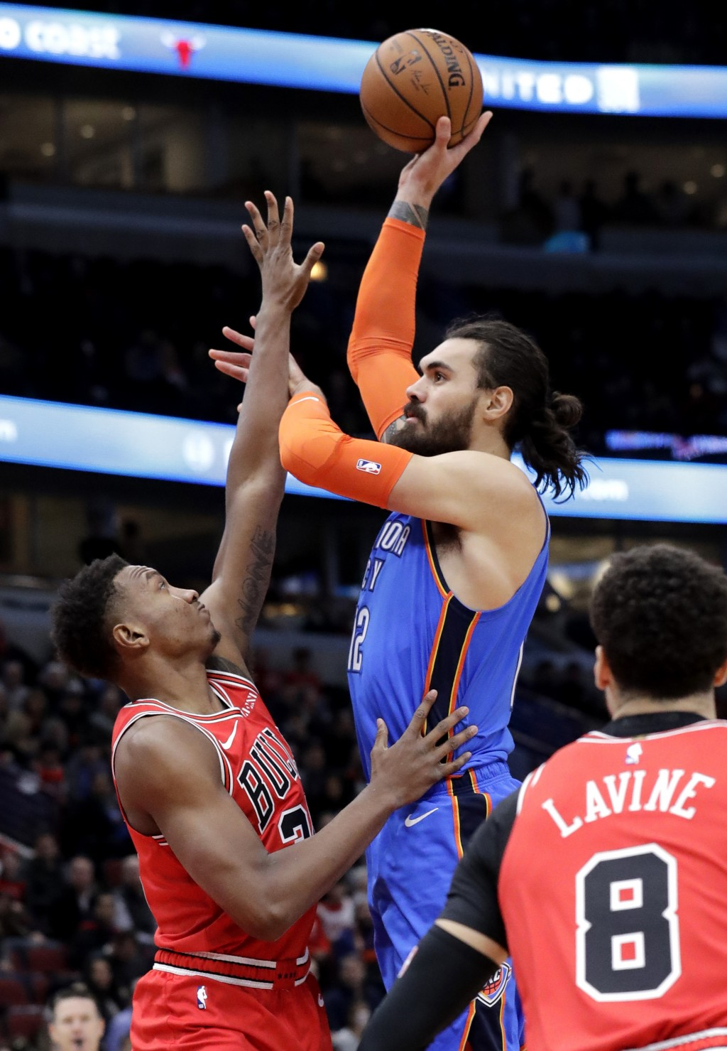 Oklahoma City Thunder center Steven Adams, right, shoots over Chicago Bulls center Wendell Carter Jr., during the first half of an NBA basketball game