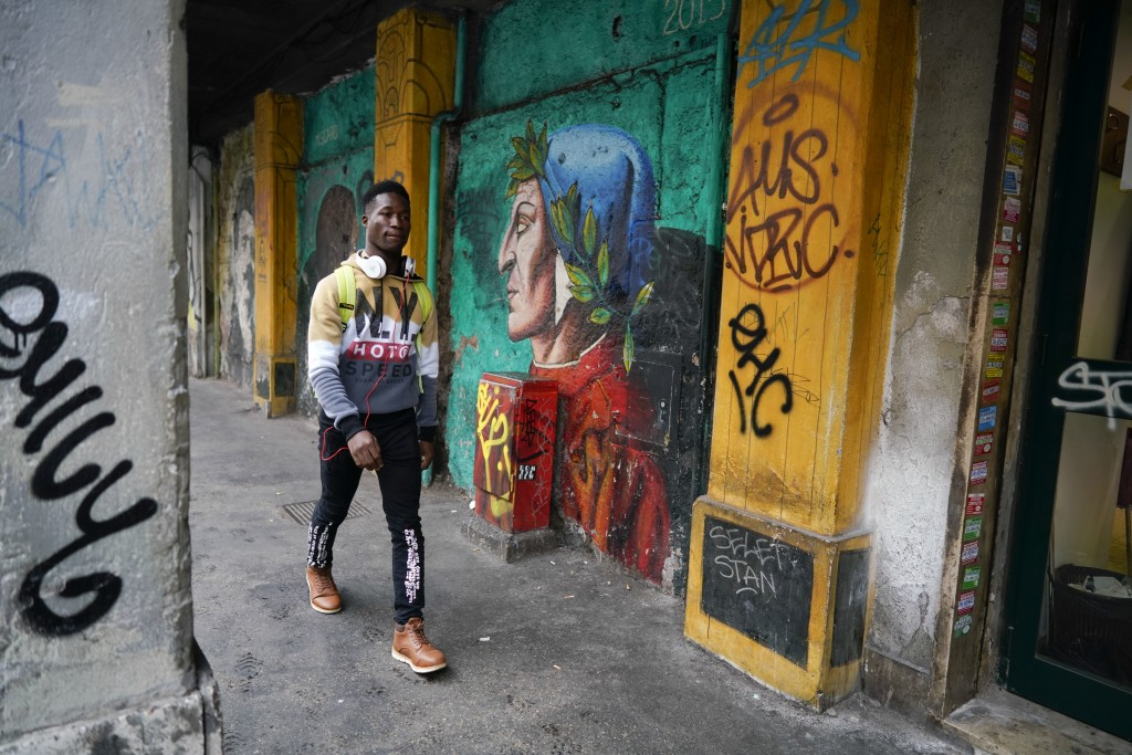 In this photo taken on Thursday, Dec. 6, 2018, Barry Tierno, 19, from Burkina Faso arrives for an interview with The Associated Press, in Rome. Thousa