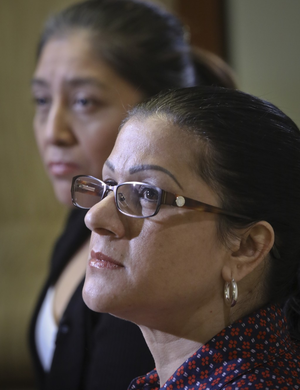 Victorina Morales, left, and Sandra Diaz, right, listen during an interview where they recalled their experience working at President Donald Trump's g
