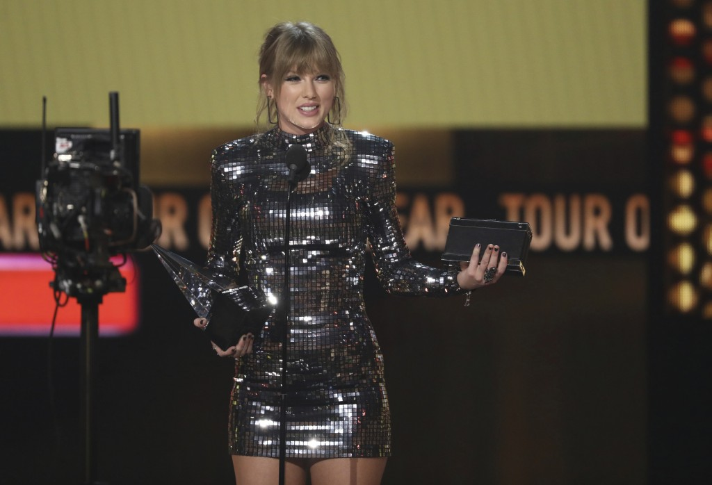 FILE - In this Oct. 9, 2018 file photo, Taylor Swift accepts the award for tour of the year at the American Music Awards at the Microsoft Theater in L