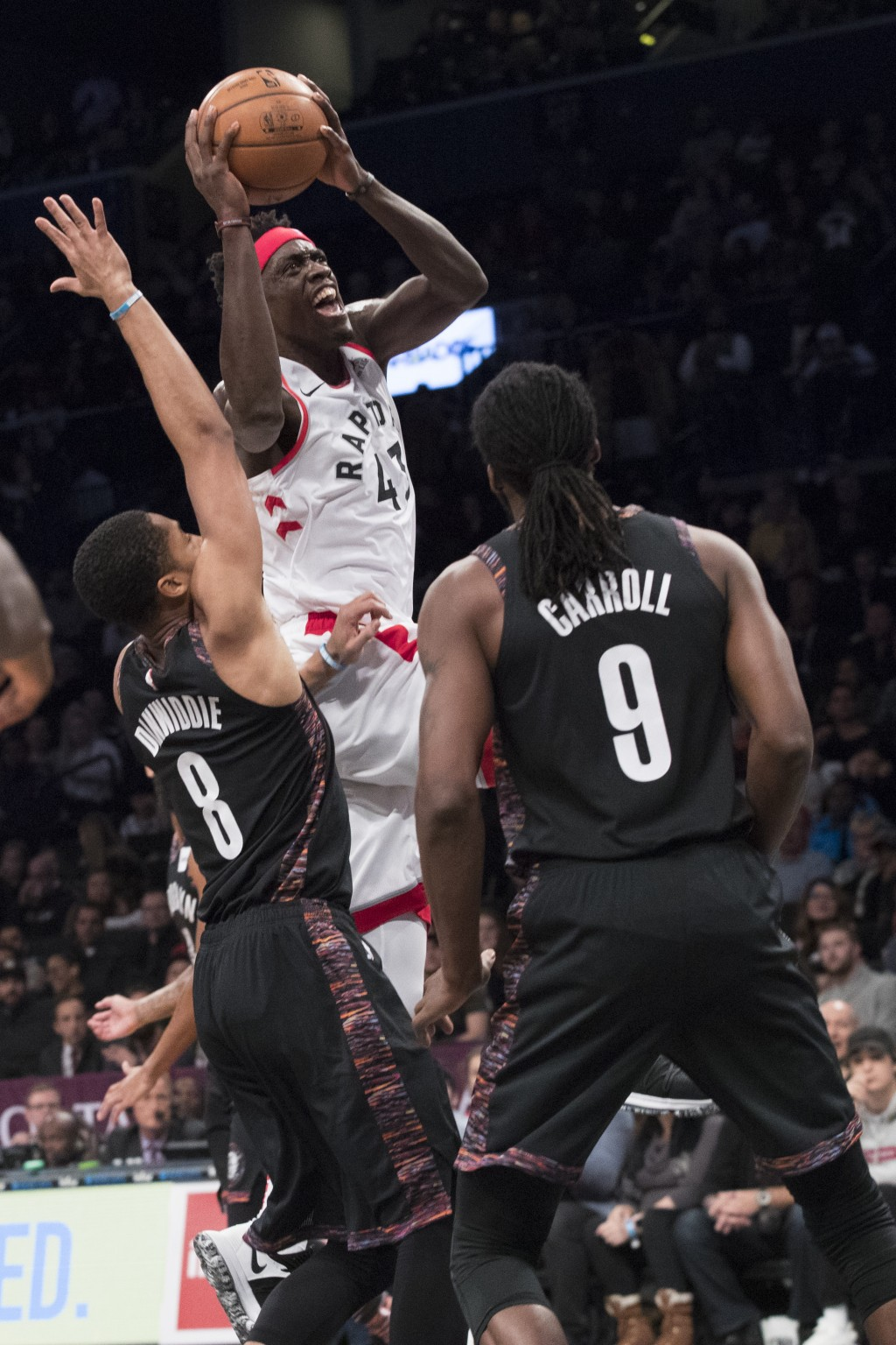 Toronto Raptors forward Pascal Siakam (43) goes to the basket against Brooklyn Nets guard Spencer Dinwiddie (8) and forward DeMarre Carroll (9) during