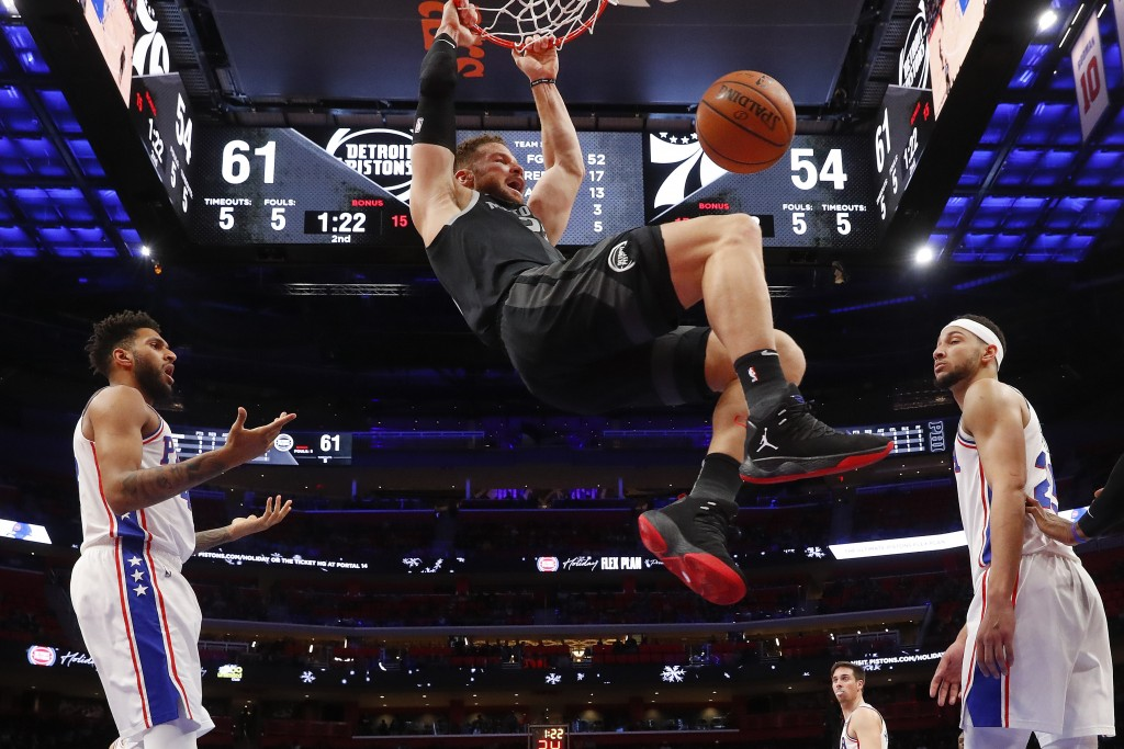 Detroit Pistons forward Blake Griffin (23) dunks against the Philadelphia 76ers in the first half of an NBA basketball game in Detroit, Friday, Dec. 7