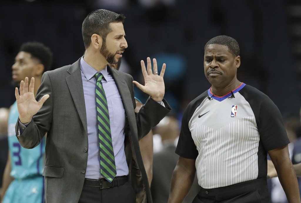 Charlotte Hornets coach James Borrego, left, argues a call during the first half of the team's NBA basketball game against the Denver Nuggets in Charl