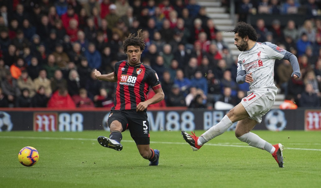 Liverpool's Mohamed Salah, right, scores his side's second goal of the game during their English Premier League soccer match against Bournemouth at th