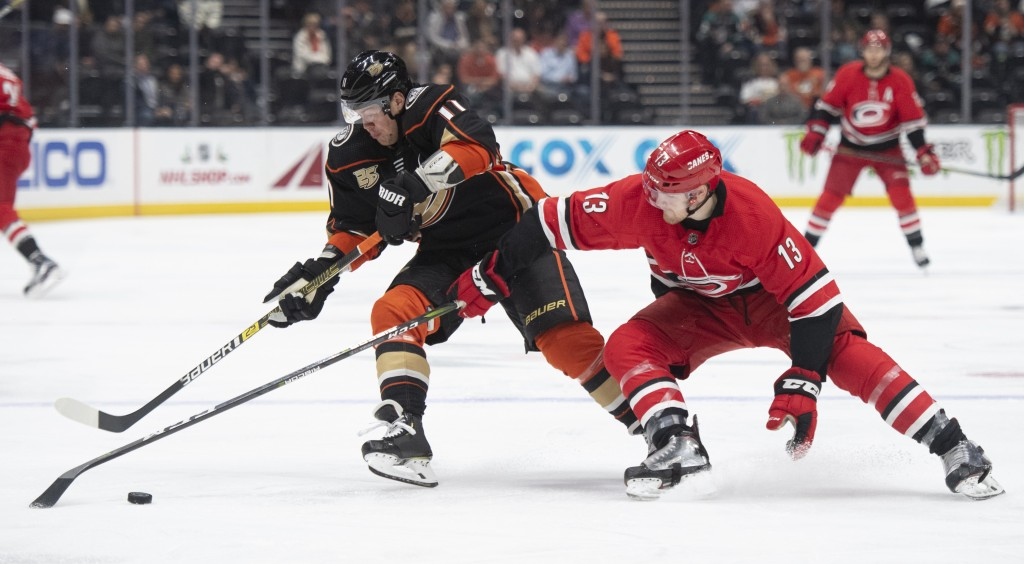 Anaheim Ducks right wing Daniel Sprong, left, and Carolina Hurricanes left wing Warren Foegele compete for the puck during the first period of an NHL