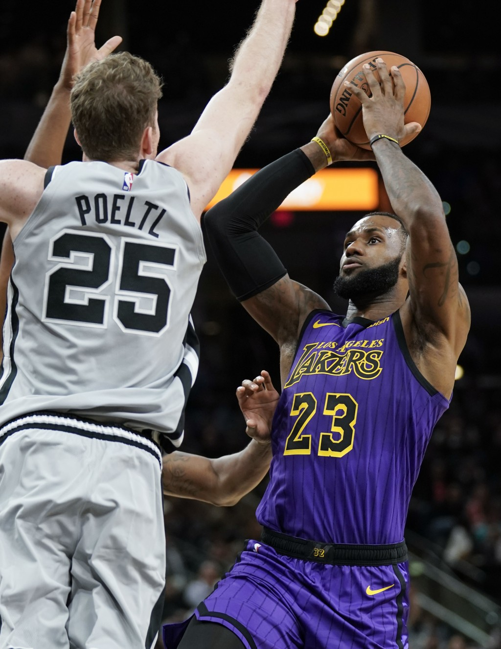 Los Angeles Lakers' LeBron James (23) shoots against San Antonio Spurs' Jakob Poeltl during the first half of an NBA basketball game Friday, Dec. 7, 2