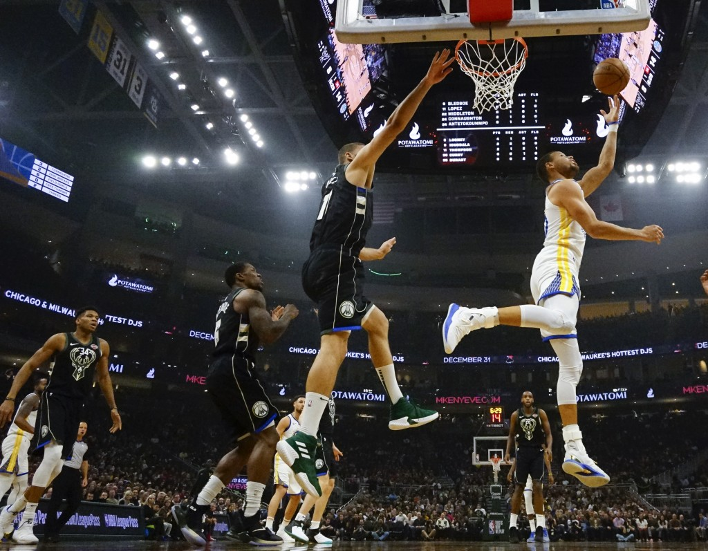 Golden State Warriors' Stephen Curry shoots during the first half of an NBA basketball game against the Milwaukee Bucks Friday, Dec. 7, 2018, in Milwa