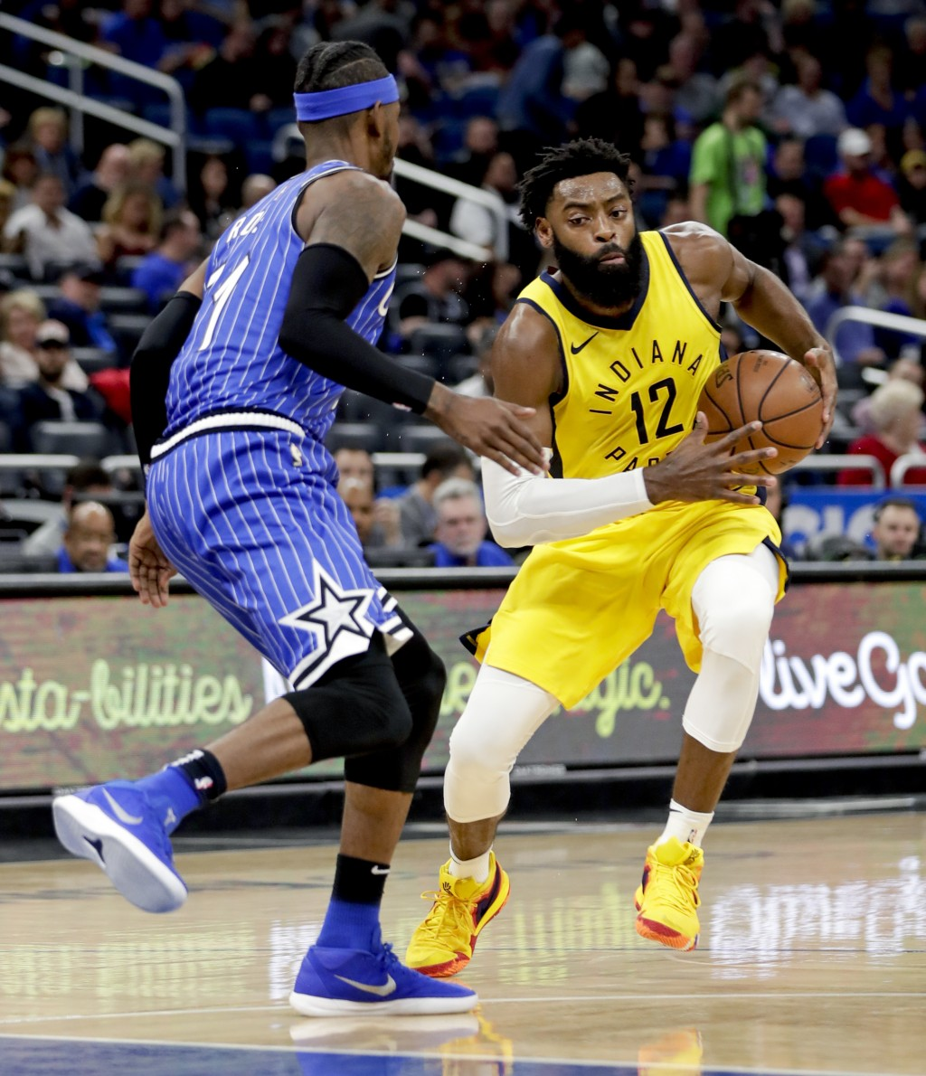 Indiana Pacers' Tyreke Evans (12) makes a move to get around Orlando Magic's Terrence Ross, left, during the first half of an NBA basketball game Frid...