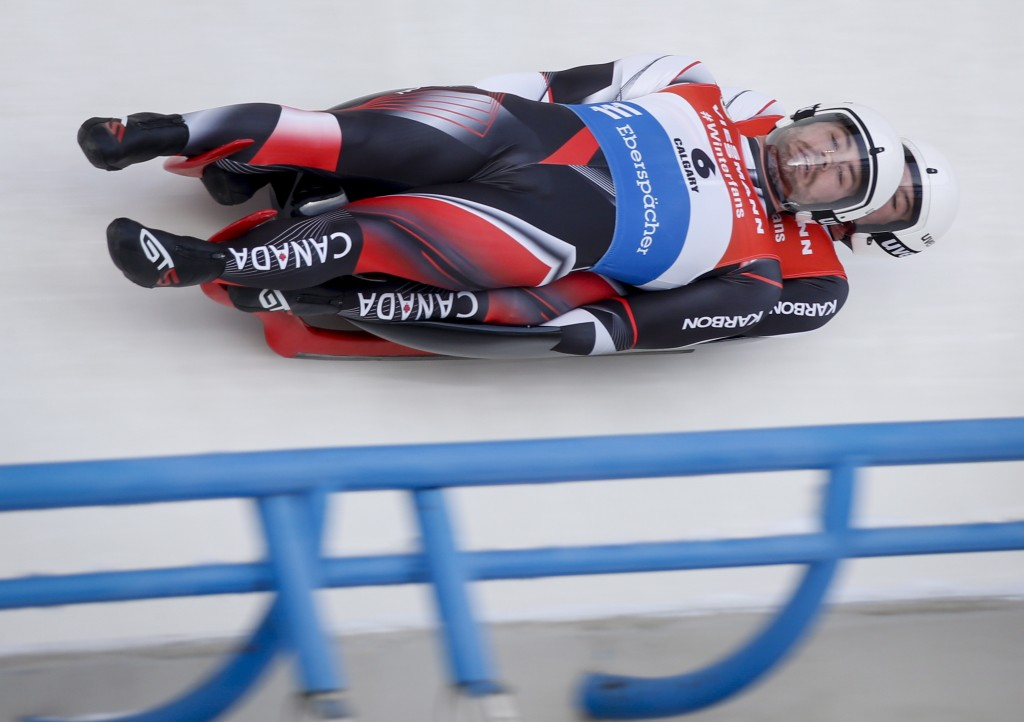 Canada's Tristan Walker and Justin Snith race down the track during the doubles World Cup luge competition in Calgary, Friday, Dec. 7, 2018. (Jeff McI