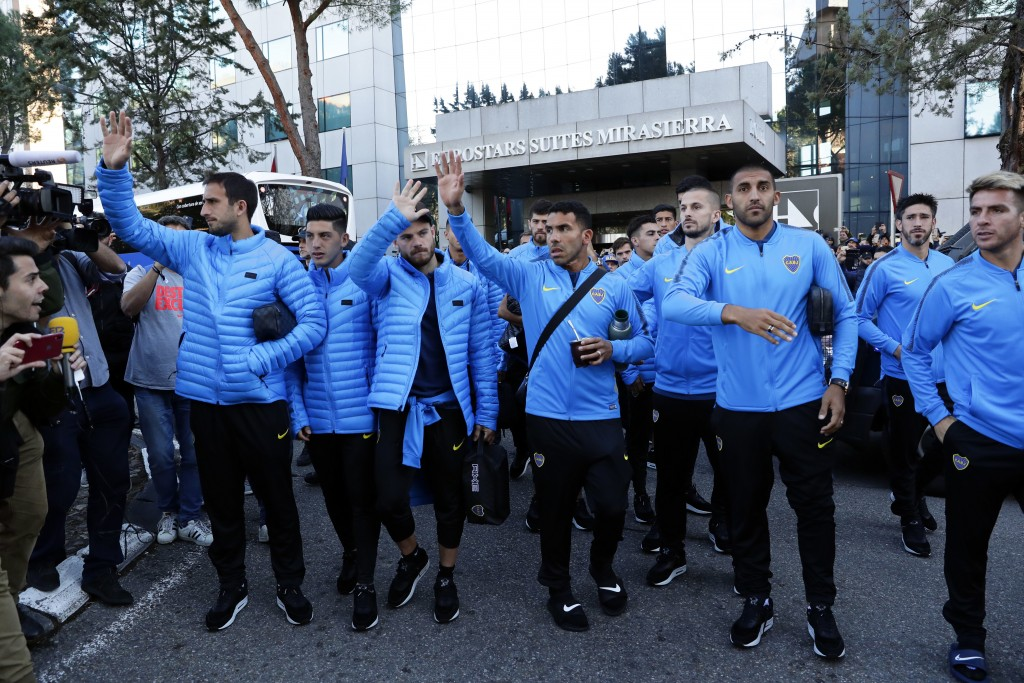 Boca Juniors players wave to supporters outside the team hotel in Madrid Saturday, Dec. 8, 2018. The Copa Libertadores Final between River Plate and B