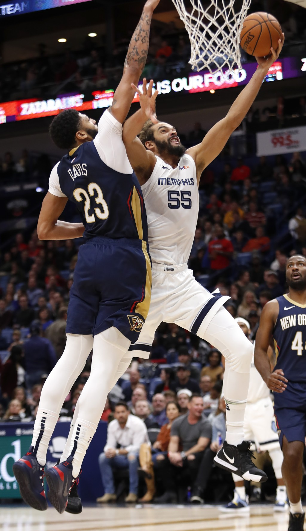 Memphis Grizzlies center Joakim Noah (55) shoots over New Orleans Pelicans forward Anthony Davis (23) in the first half of an NBA basketball game in N