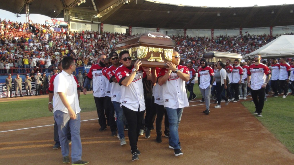 Players from the Cardenales de Lara baseball team carry the caskets of teammates and former major league players Luis Valbuena and Jose Castillo at a