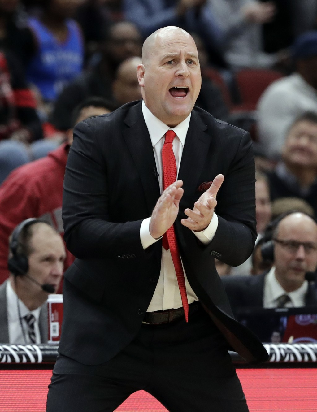 Chicago Bulls coach Jim Boylen calls out to his team during the first half of an NBA basketball game against the Oklahoma City Thunder, Friday, Dec. 7