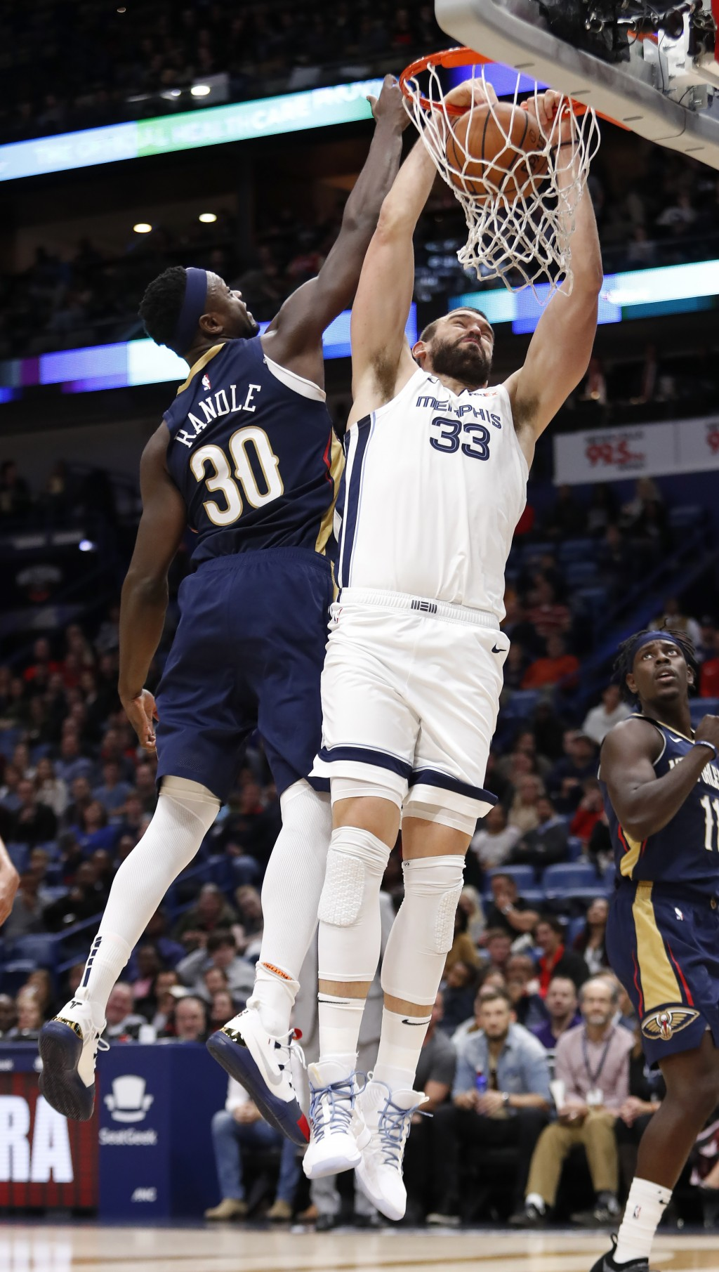 Memphis Grizzlies center Marc Gasol (33) dunks the ball over New Orleans Pelicans forward Julius Randle (30) in the first half of an NBA basketball ga