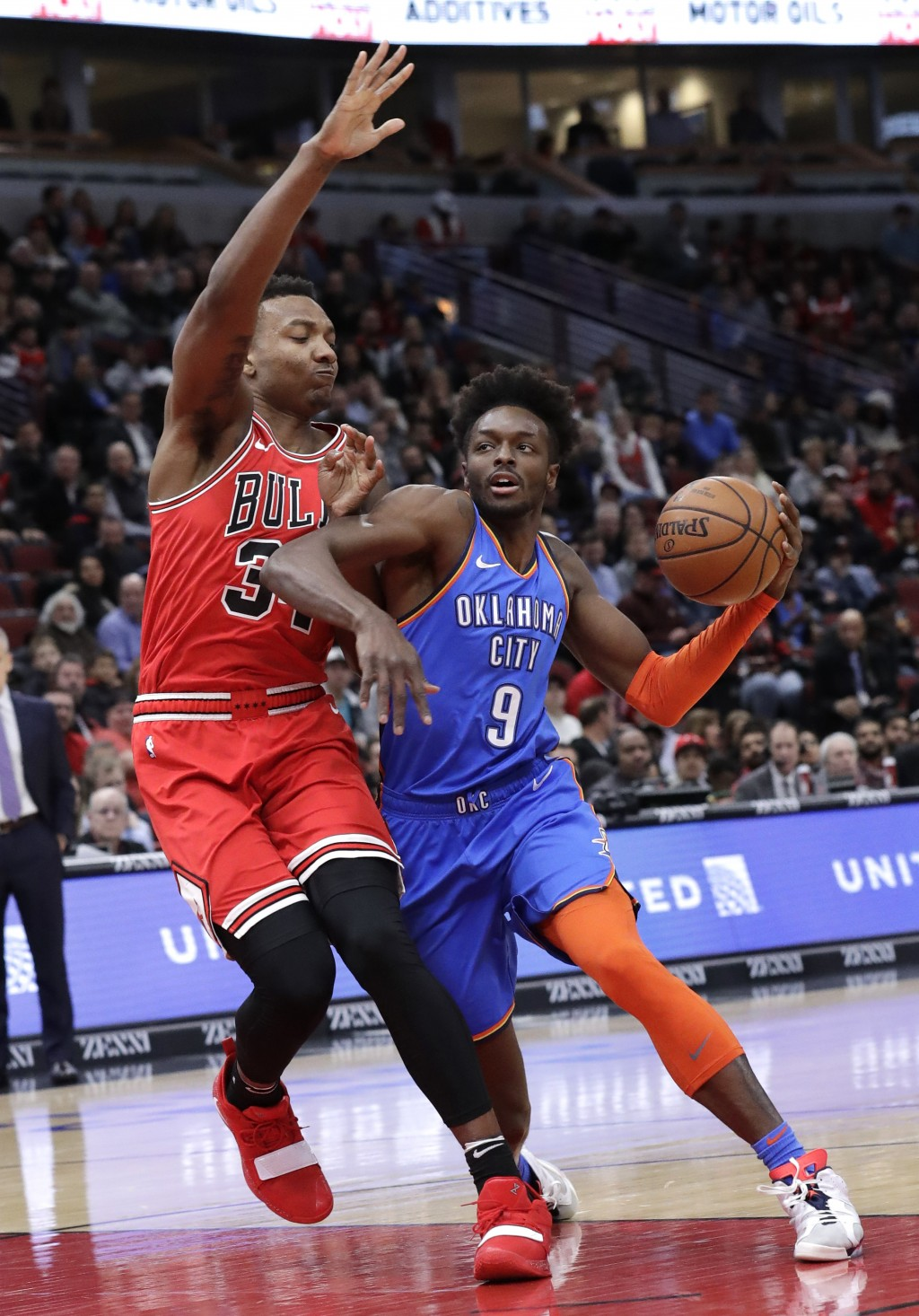 Oklahoma City Thunder forward Jeramy Grant, right, drives as Chicago Bulls center Wendell Carter Jr. defends during the first half of an NBA basketbal