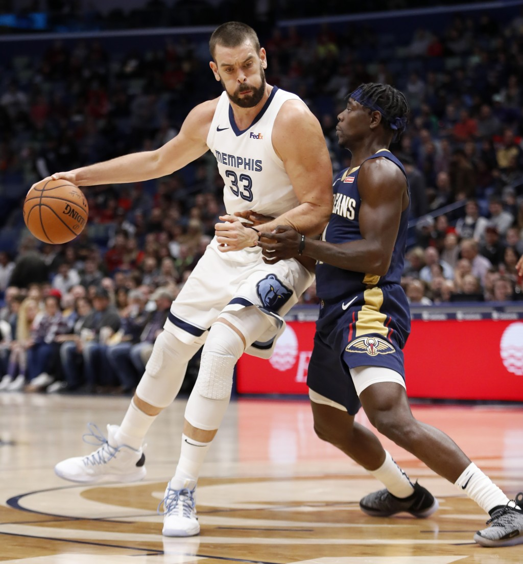 Memphis Grizzlies center Marc Gasol (33) is guarded by New Orleans Pelicans guard Jrue Holiday (11) in the first half of an NBA basketball game in New