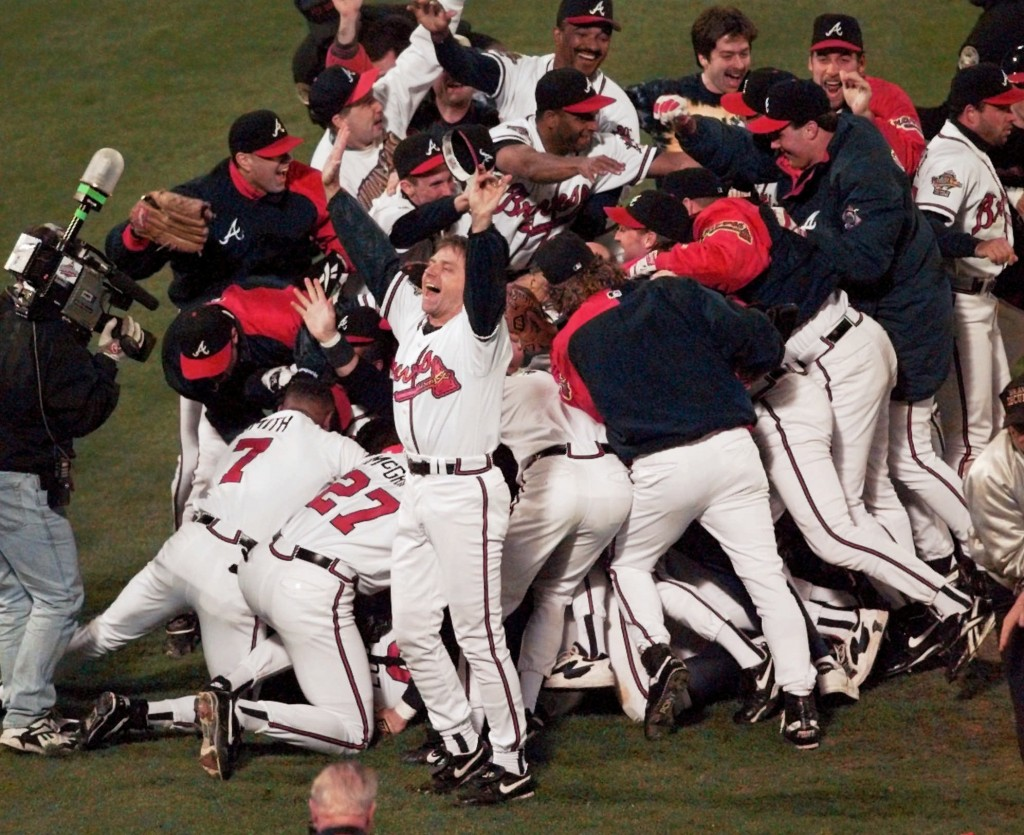 FILE - In this Oct. 28, 1995, file photo, the Atlanta Braves celebrate after Game 6 of the baseball World Series in Atlanta. The Braves defeated the C