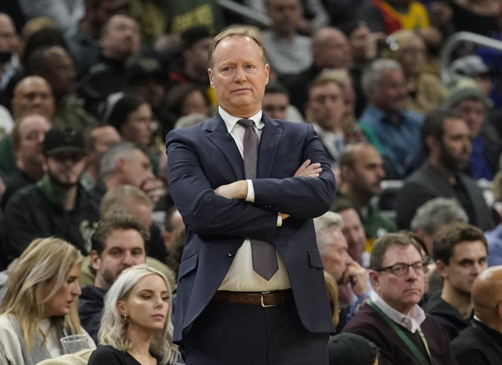 Milwaukee Bucks head coach Mike Budenholzer watches during the first half of an NBA basketball game against the Golden State Warriors Friday, Dec. 7,