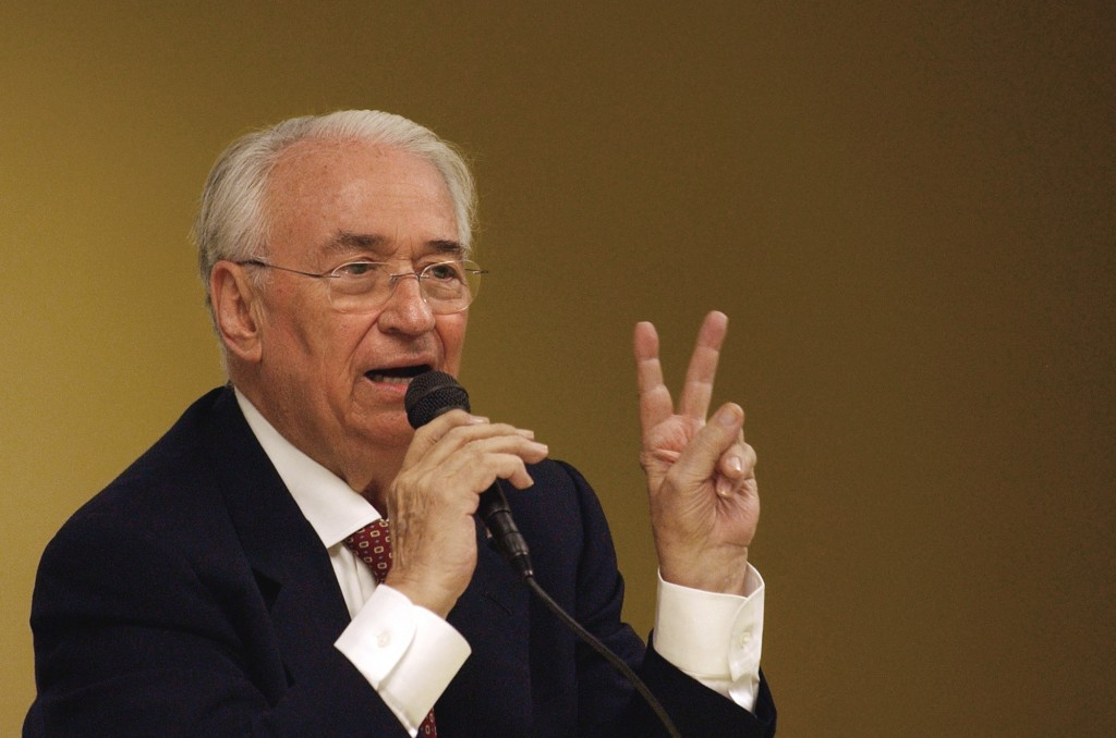 FILE - In this July 23, 2004 file photo, Colombia's former President Belisario Betancur speaks during a conference about democracy in Latin America in