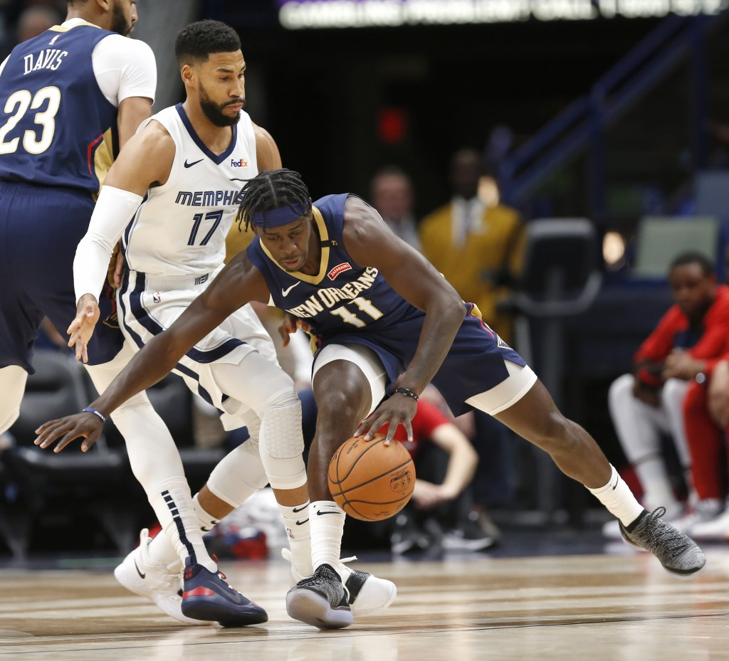 New Orleans Pelicans guard Jrue Holiday (11) is guarded by Memphis Grizzles guard Garrett Temple (17) in the first half of an NBA basketball game in N