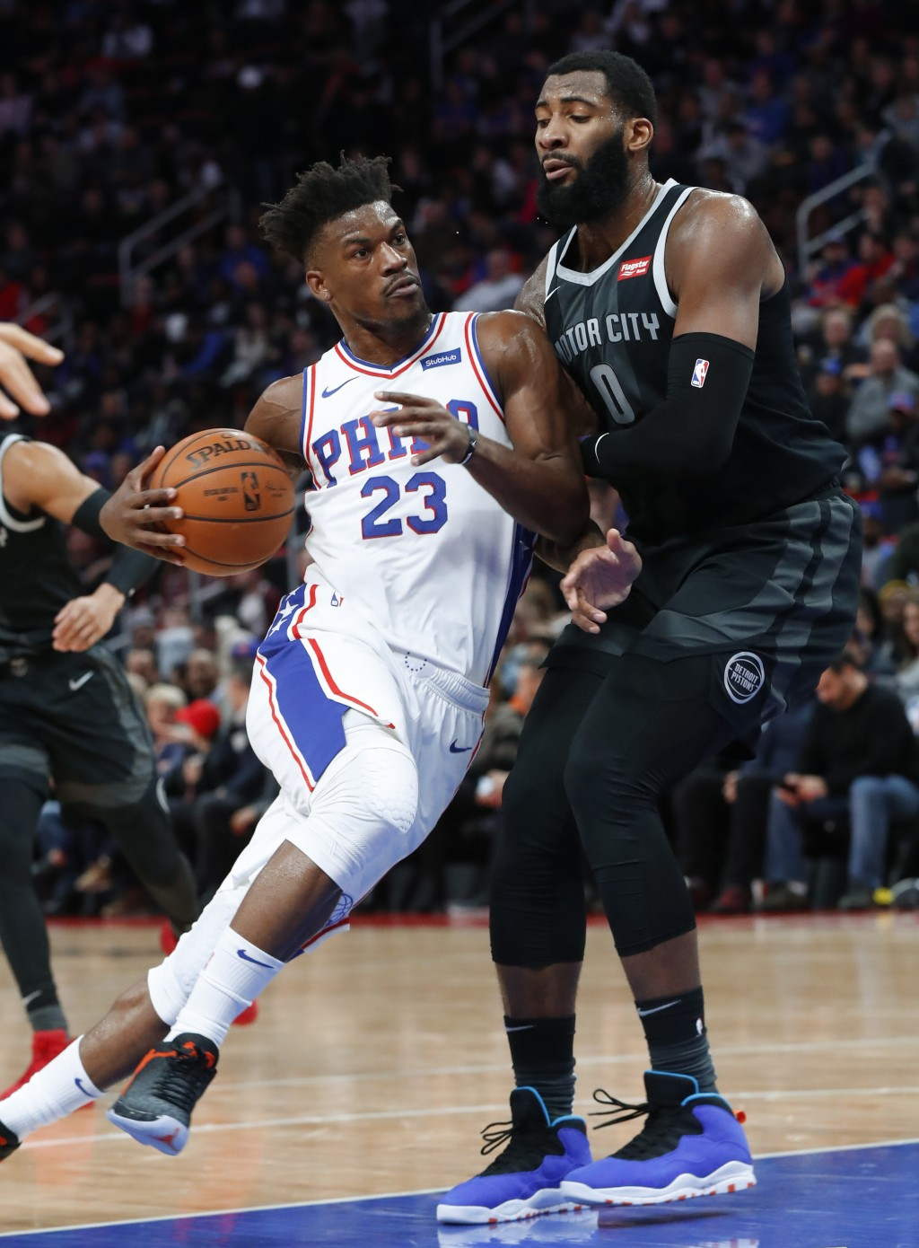 Philadelphia 76ers guard Jimmy Butler (23) drives against Detroit Pistons center Andre Drummond (0) in the second half of an NBA basketball game in De