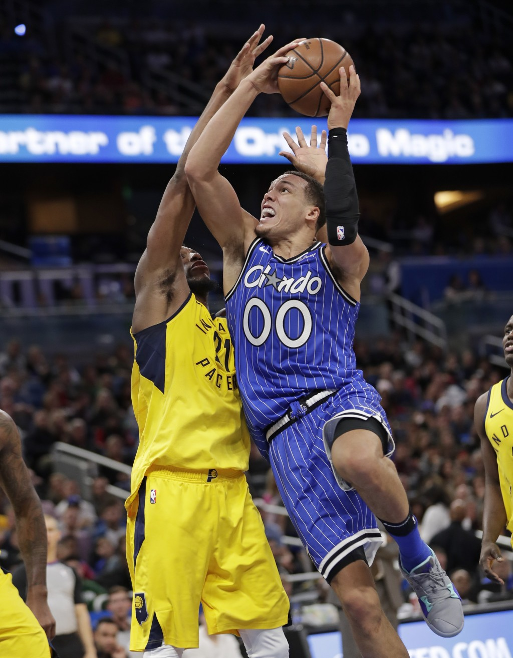 Orlando Magic's Aaron Gordon (00) goes up for a shot against Indiana Pacers' Thaddeus Young during the second half of an NBA basketball game Friday, D...