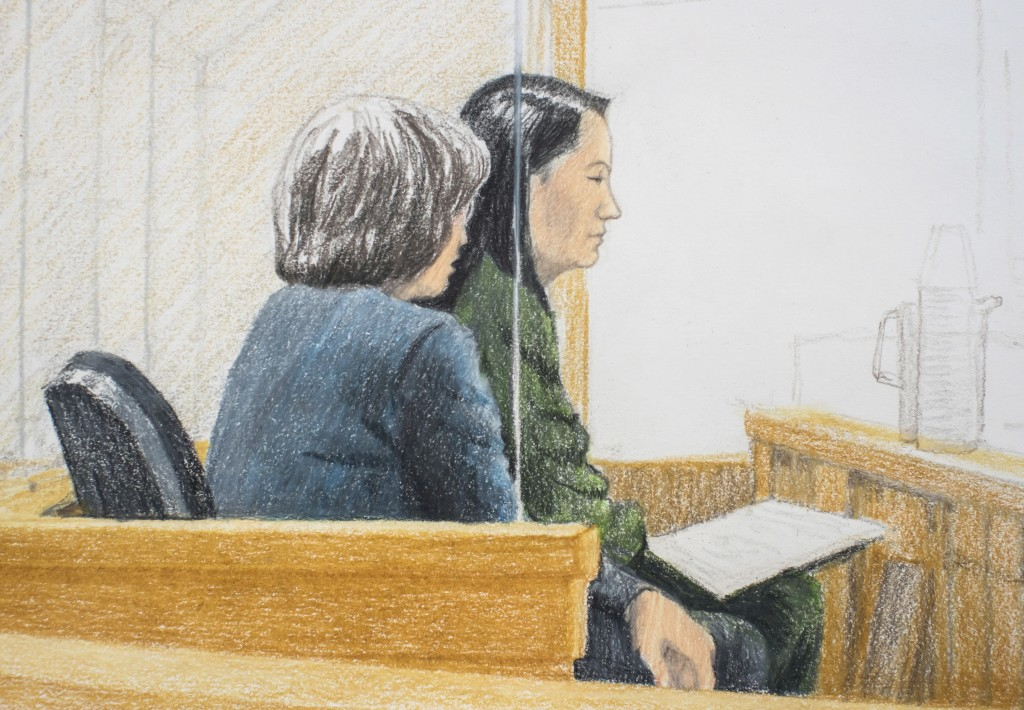 In this courtroom sketch Meng Wanzhou right the chief financial officer of Huawei Technologies sits beside a translator during a bail hearing at B