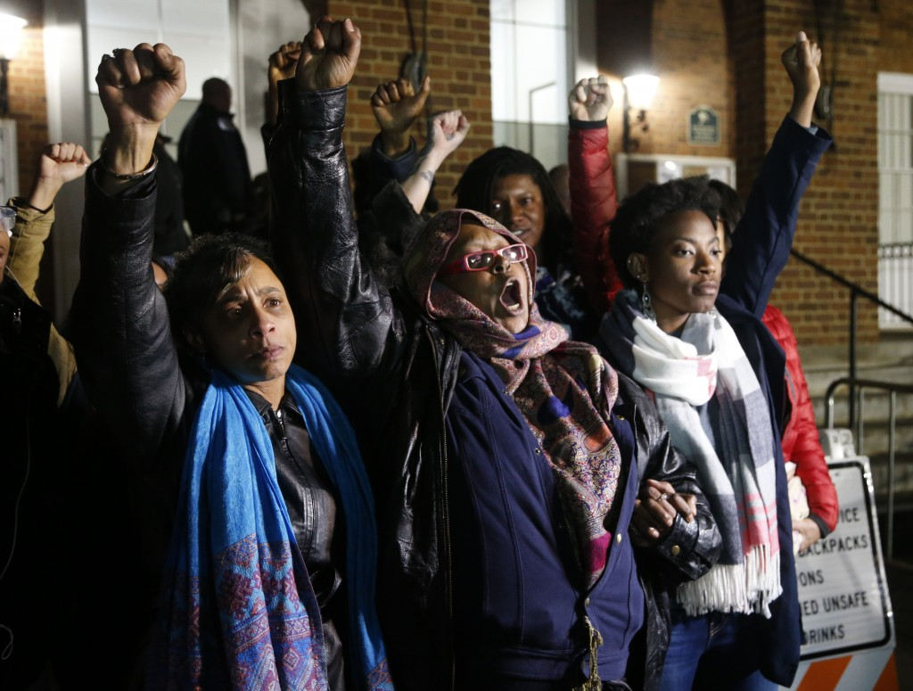 Local activists raise their fists outside Charlottesville General District Court after a guilty verdict was reached in the trial of James Alex Fields