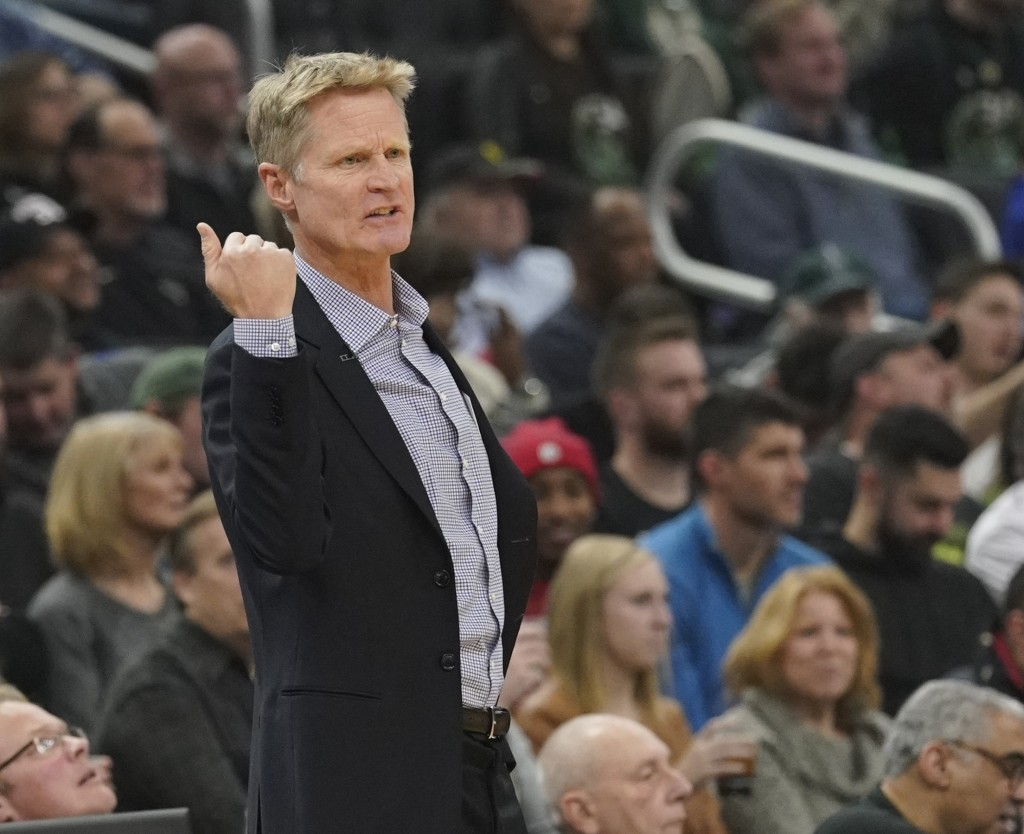 Golden State Warriors head coach Steve Kerr reacts during the first half of an NBA basketball game against the Milwaukee Bucks Friday, Dec. 7, 2018, i