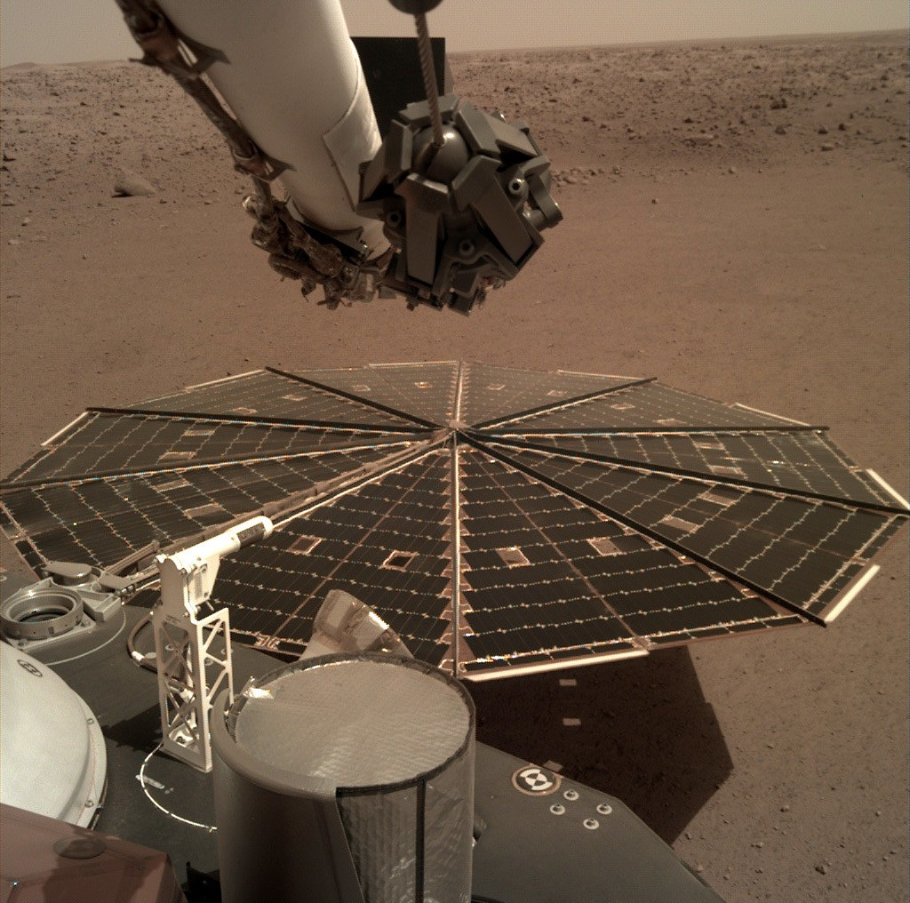 This Friday, Dec. 7, 2018 photo made available by NASA shows a view from the arm-mounted camera on the InSight Mars lander. The spacecraft arrived on