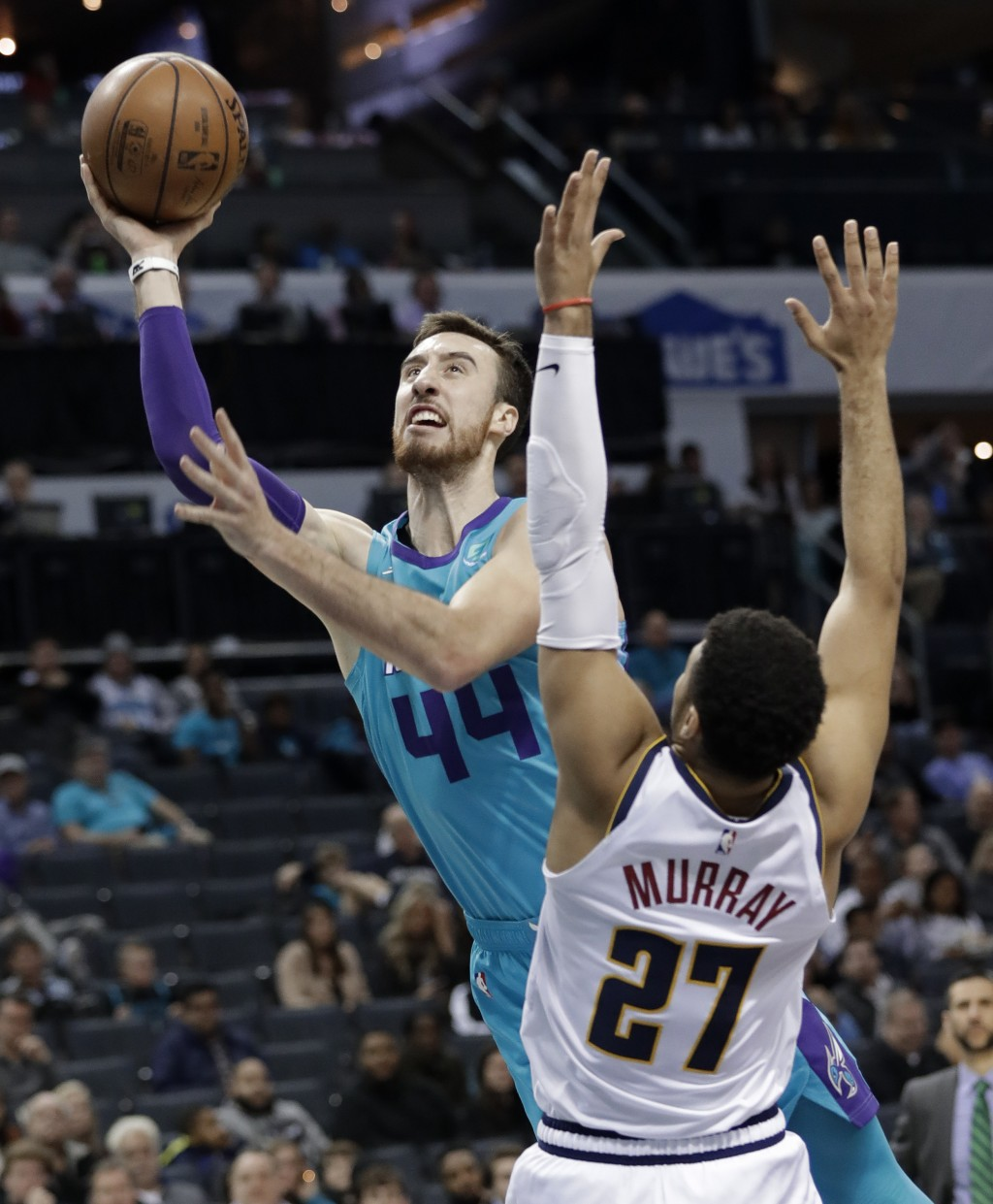 Charlotte Hornets' Frank Kaminsky (44) drives past Denver Nuggets' Jamal Murray (27) during the first half of an NBA basketball game in Charlotte, N.C