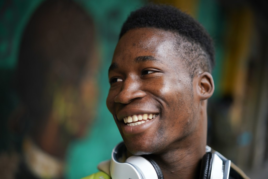 In this photo taken on Thursday, Dec. 6, 2018, Barry Tierno, 19, from Burkina Faso smiles during an interview with The Associated Press, in Rome. Thou