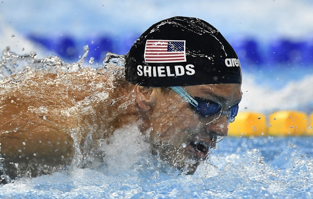 FILE - In this Thursday, Aug. 11, 2016 file photo, United States' Tom Shields competes in a men's 100-meter butterfly semifinal during the swimming co
