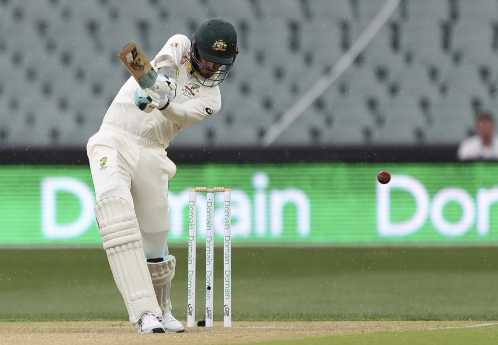 Australia's Mitchell Starc plays at the ball to be out caught behind during the first cricket test between Australia and India in Adelaide, Australia,