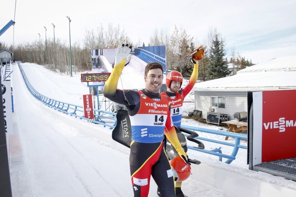 Germany's Tobias Wendl, left, and Tobias Arlt, celebrate their victory in the men's doubles World Cup luge competition in Calgary, Alberta, Friday, De