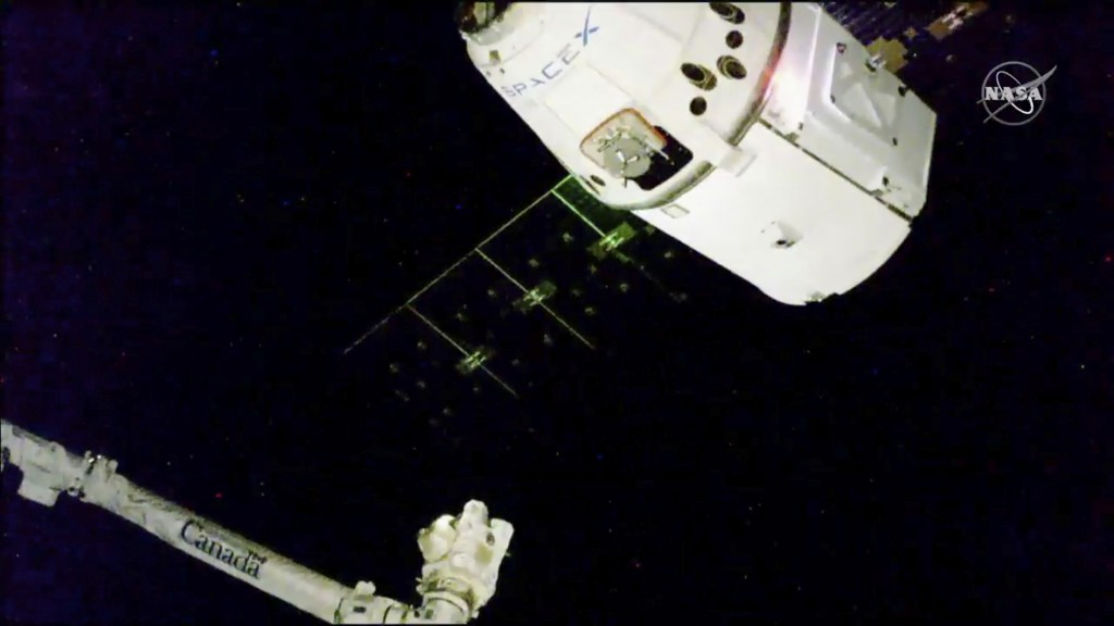 In this image taken from NASA Television, the SpaceX Dragon cargo spacecraft approaches the robotic arm for docking to the International Space Station