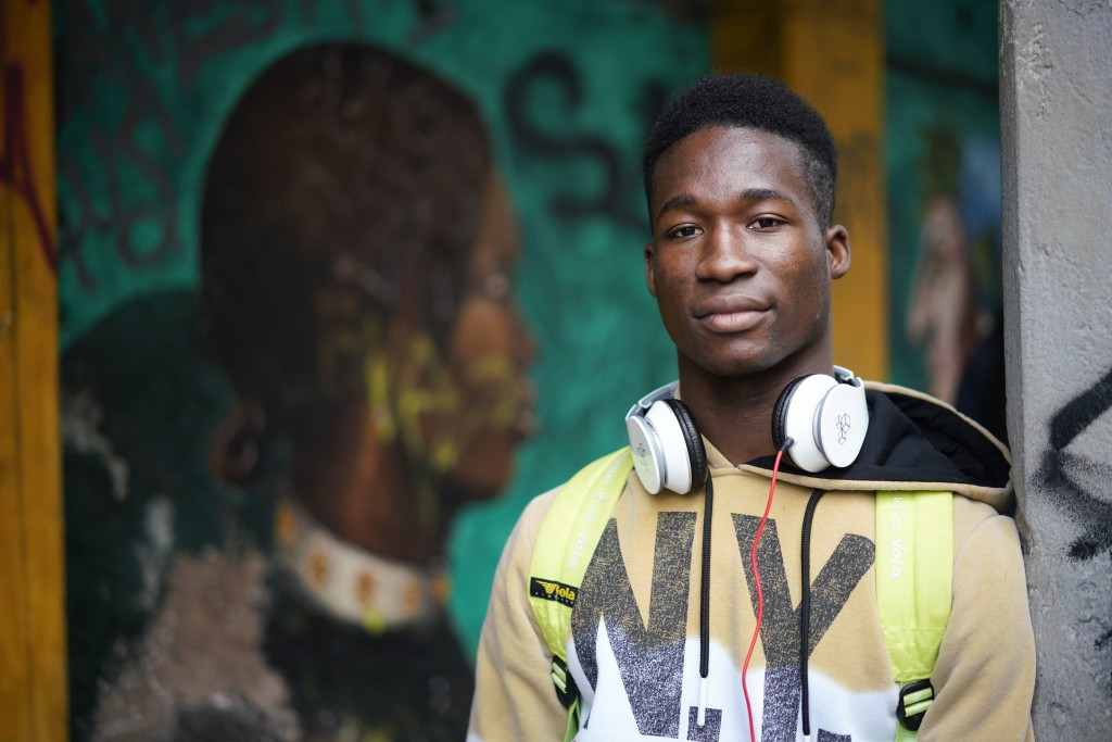 In this photo taken on Thursday, Dec. 6, 2018, Barry Tierno, 19, from Burkina Faso poses during an interview with The Associated Press, in Rome. Thous