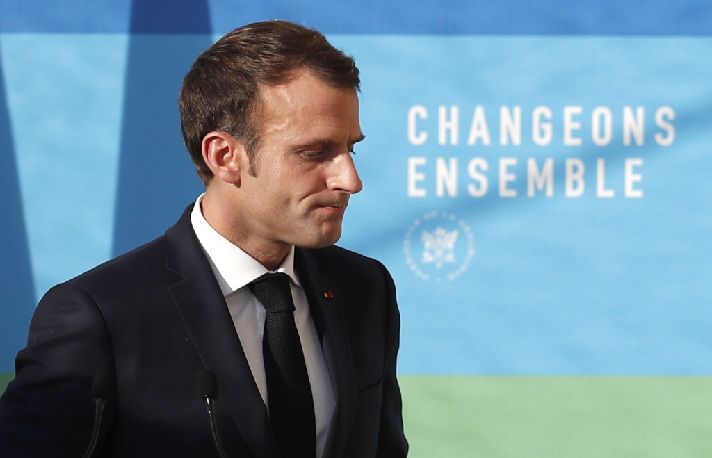 FILE - In this Nov.27, 2018 file photo, French President Emmanuel Macron leaves after delivering a speech on 'The presentation of the strategy for eco