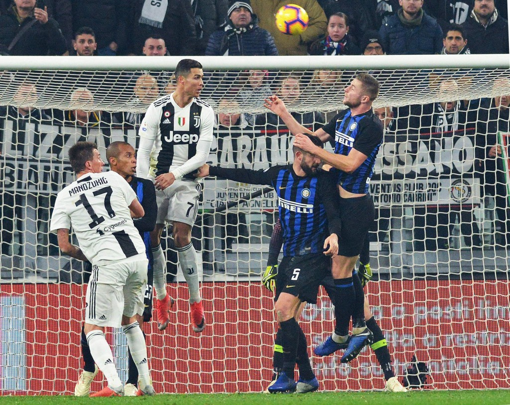 Juventus' Cristiano Ronaldo, 3rd from left, heads the ball during the Serie A soccer match between Juventus and Inter Milan at the Turin Allianz stadi