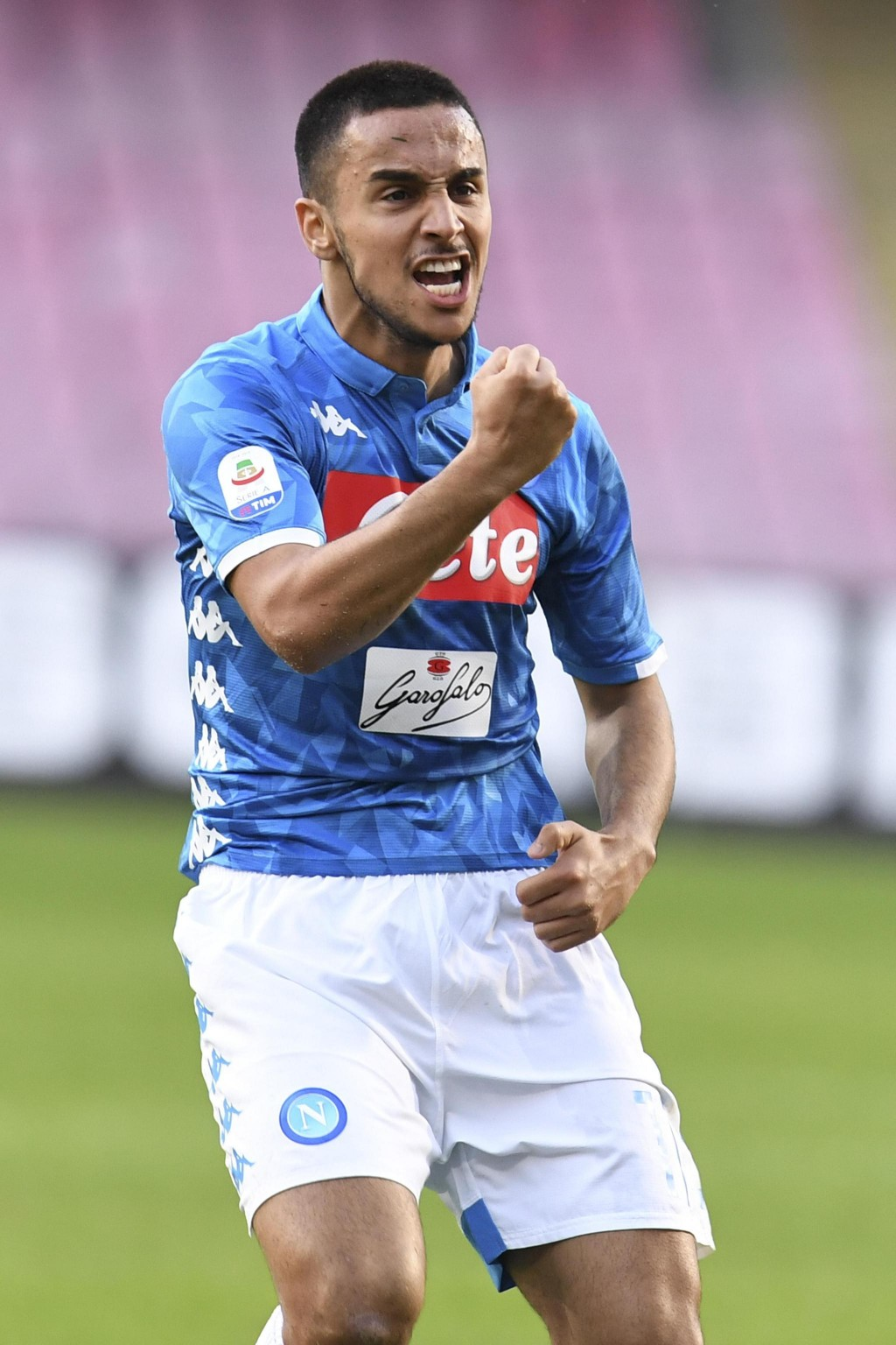 Napoli's Adam Ounas celebrates after scoring his side's second goal during the Serie A soccer match between Napoli and Frosinone, at the San Paolo sta...