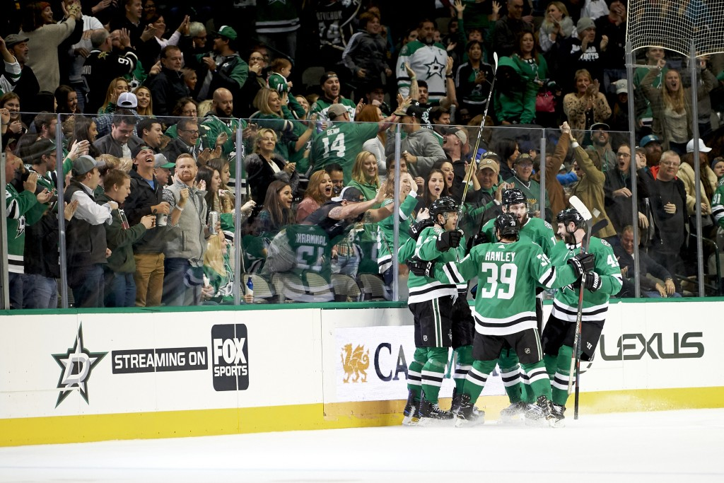 Dallas Stars center Mattias Janmark (13) celebrates with teammates after scoring a goal against the San Jose Sharks during the second period of an NHL