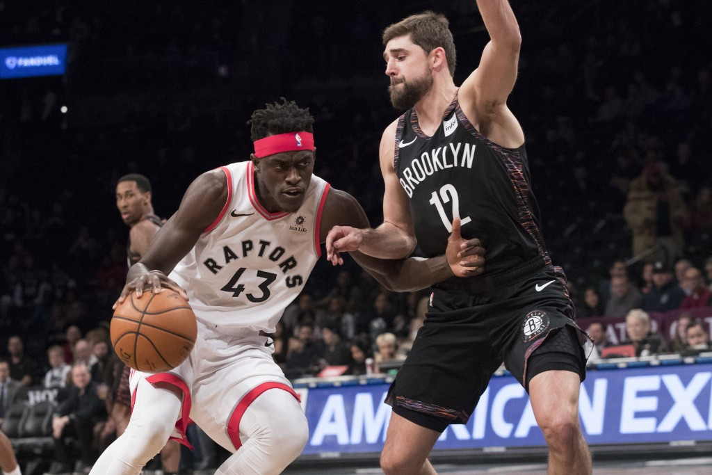 Toronto Raptors forward Pascal Siakam (43) drives to the basket against Brooklyn Nets forward Joe Harris (12) during the first half of an NBA basketba