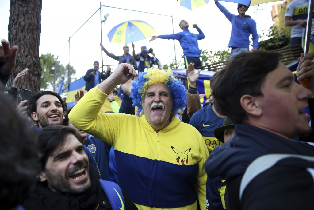 Boca Juniors supporters cheer during a gathering outside the team hotel in Madrid Saturday, Dec. 8, 2018. The Copa Libertadores Final between River Pl