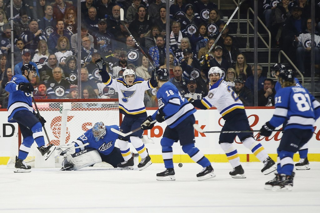 St. Louis Blues' Robert Thomas (18) and Alexander Steen (20) celebrate Steen's goal against Winnipeg Jets goaltender Connor Hellebuyck (37) during the