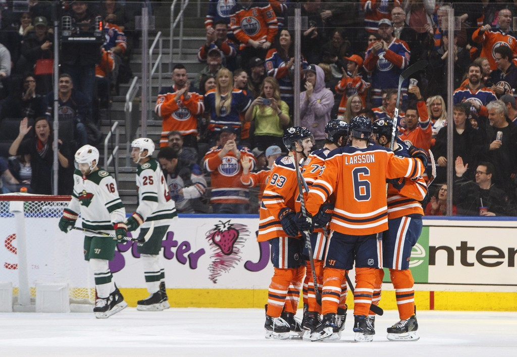 Edmonton Oilers celebrate a goal against the Minnesota Wild during the third period in an NHL hockey game in Edmonton, Alberta, Friday, Dec. 7, 2018.