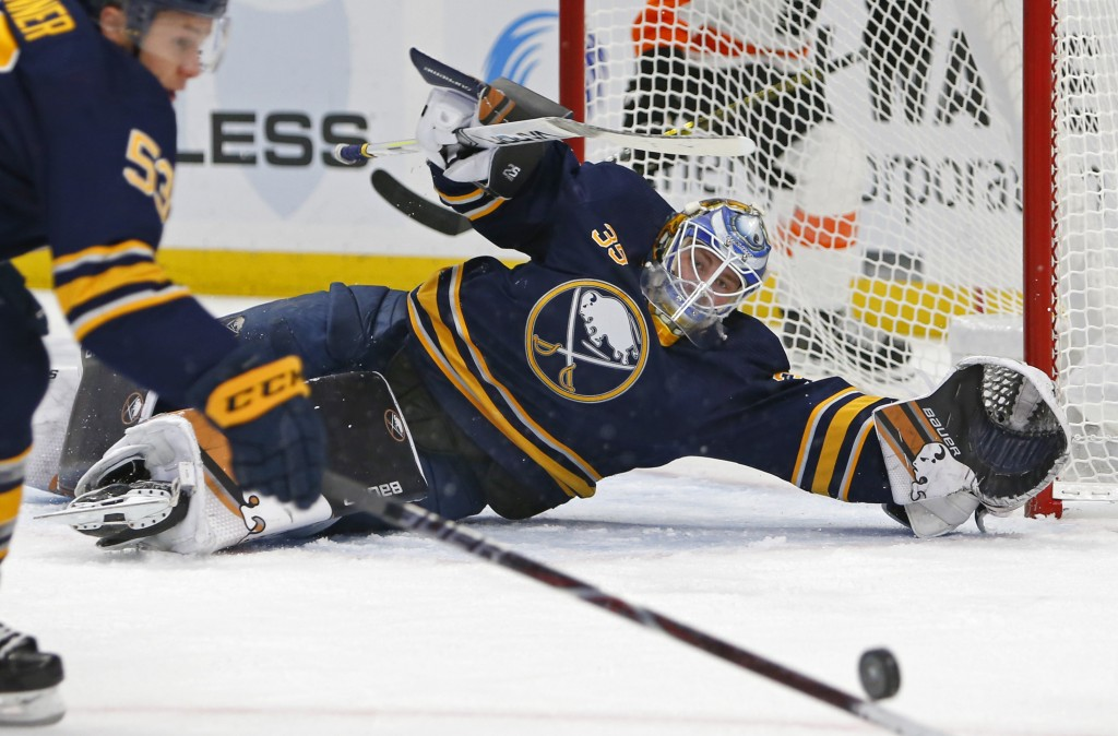 Buffalo Sabres goalie Linus Ullmark (35) makes a save during the second period of an NHL hockey game against the Philadelphia Flyers, Saturday, Dec. 8